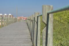Perspective view of wooden pedestrian walkway, towards the ocean, next to the beach, Portugal royalty free stock image