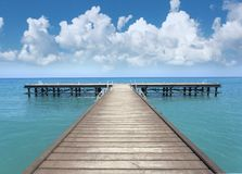 Perspective view of a wooden pier Royalty Free Stock Images