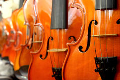Perspective of violin. Perspective of many violin in music room Stock Images