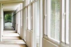 Perspective of pillars and windows. Perspective of a white building interior with pillars and windows Royalty Free Stock Photo