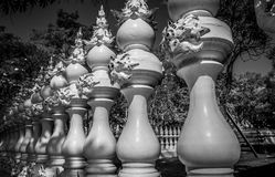 Perspective with white carved fence being like chess pieces Stock Photos