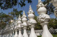 Perspective with white carved fence being like chess pieces Royalty Free Stock Images