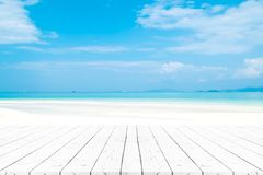 Free Perspective White Pearl Wooden Table On Top Over Blur Sea In Sun Royalty Free Stock Photos - 117309408