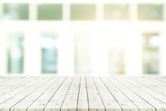 Perspective white wooden table on top over blur background view Royalty Free Stock Photos