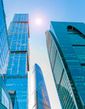 Perspective wide angle view to blue glass building skyscrapers Royalty Free Stock Photos