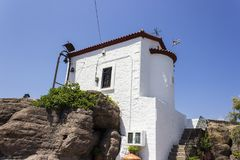 Perspective wide shot of near sea masonry white painted building in Lemonas at Lesvos. At summertime stock photos