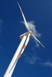 Perspective of wind mill. Up perspective of wind mill power generator against blue sky Royalty Free Stock Photos