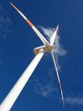 Perspective of wind mill. Up perspective of wind mill power generator against blue sky Stock Images
