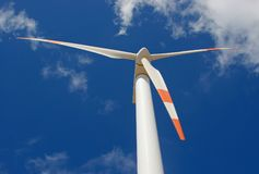 Perspective of wind mill. Up perspective of wind mill power generator against blue sky Stock Image