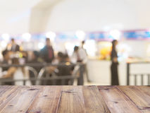 Perspective wood and blurred food court with crowd people. Stock Image