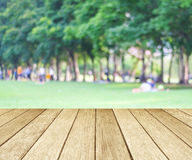 Perspective wood with blurred people activities in park backgrou Stock Images