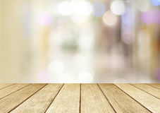 Perspective wood and blurred store with bokeh background Stock Photos