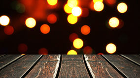 Perspective wood and bokeh background of night and the shimmering glare of the lights. display template item.  Stock Images
