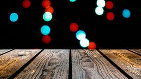 Perspective wood and bokeh background of night and the shimmering glare of the lights. display template item.  Stock Photos