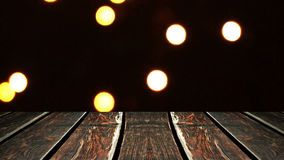 Perspective wood and bokeh background of night and the shimmering glare of the lights. display template item.  Royalty Free Stock Photography