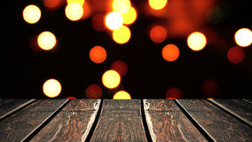 Perspective wood and bokeh background of night and the shimmering glare of the lights. display template item.  Stock Photography
