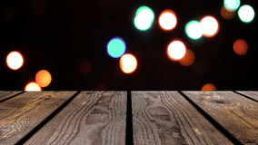 Perspective wood and bokeh background of night and the shimmering glare of the lights. display template item.  Stock Photo