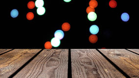 Perspective wood and bokeh background of night and the shimmering glare of the lights. display template item.  Royalty Free Stock Images