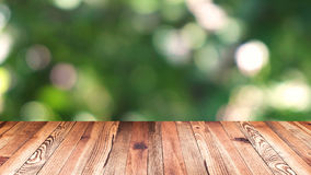 Perspective wood and bokeh light background. product display template. Wood table top on blur moving natural green leaf. Background Royalty Free Stock Image