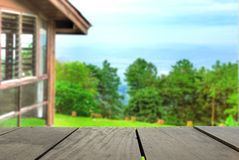 Perspective wood over blur beautiful resort and landscape mountain Stock Photos