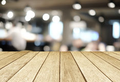 Perspective wood over blurred restaurant with bokeh background. Foods and drinks, product display montage stock images