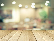 Perspective wood over blurred restaurant with bokeh background royalty free stock image