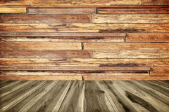 Perspective wood plank floor or walk way with old wood wall Stock Images