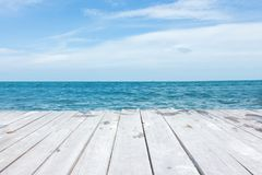 Perspective of wood terrace against beautiful seascape stock photography