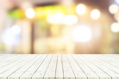 Perspective wooden table on top over blur coffee shop background. Perspective empty white wooden table over blurred shopping mall background, for product display Stock Images