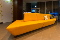 Perspective of yellow couch stock photo