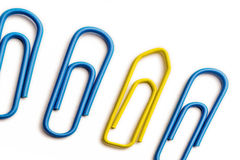 Perspective yellow paperclip stock image