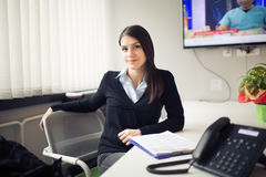 Perspective young female worker business woman day in office.Confident,smart and organized assistant.Managing business.Consultant Royalty Free Stock Photo