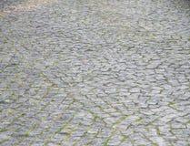 Perspektiven-Ansicht von monotonem Gray Brick Stone Street Road Hintergrund Lizenzfreies Stockfoto