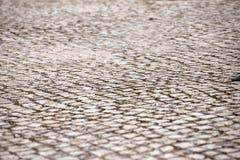 Perspektivet - abstrakt begrepp - kullerstentextur - vaggar Royaltyfria Foton