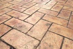 Perspektywiczny widok Brown cegły kamienia ulicy droga Chodniczek, bruk tekstura zdjęcia stock