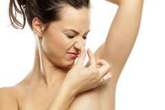 Perspiration - smelly armpits stock photo