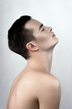 Perspiring male model in profile Stock Images