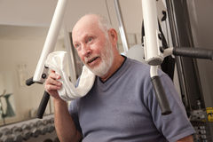 Perspiring Senior Man in the Gym Stock Image
