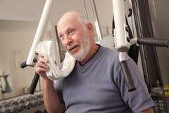 Perspiring Senior Man in the Gym Stock Image