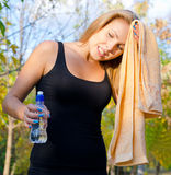 Perspiring woman athlete wiping her Stock Photography