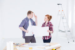 Persuading her to his design ideas Royalty Free Stock Photography