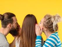 Persuasion man woman whisper girls ear royalty free stock image