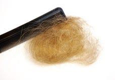 Perte des cheveux et peigne Photo stock
