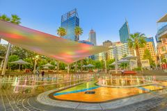 Water Park Perth sunset. Perth, Australia - Jan 6, 2018: amusing water jets, misting, lighting of a new attraction for kids of BHP Billiton Water Park in Stock Photos