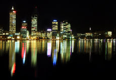 Perth City at night. With reflections mirrored in the Swan River Stock Photos