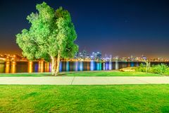 Perth Mill Point. Perth Downtown cityscape with skyscrapers reflecting on the Swan River from Mill point in Western Australia. Perth Skyline illuminated at night Royalty Free Stock Image