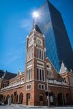 Perth Town Hall in Western Australia old brick building in front of modern skyscraper. S stock images