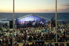 PERTH, WA / AUSTRALIA, DECEMBER 13, 2015: Stage at Christmas Carols 2015. Families enjoy chore singing at Christmas Carols 2015 event on Scarborough Beach in royalty free stock image