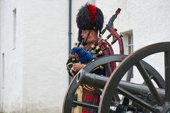 Perthshire,UK - 20 August 2016 : An army representative playing bagpipes at Blair Atholl castle. An army representative playing bagpipes at Blair Atholl castle Stock Image