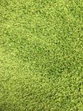 Perto amacie acima a textura verde do tapete imagens de stock
